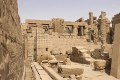 Buildings and columns of ancient Egyptian megaliths. Ancient ruins of Egyptian buildings. Royalty Free Stock Photography
