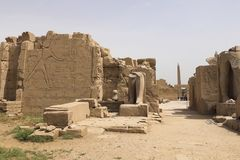 Buildings and columns of ancient Egyptian megaliths. Ancient ruins of Egyptian buildings. Stock Photos