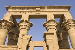 Buildings and columns of ancient Egyptian megaliths. Ancient ruins of Egyptian buildings. Royalty Free Stock Image