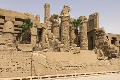 Buildings and columns of ancient Egyptian megaliths. Ancient ruins of Egyptian buildings. Buildings and columns of ancient Egyptian megaliths. Ancient ruins of Royalty Free Stock Photography