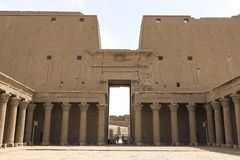 Buildings and columns of ancient Egyptian megaliths. Ancient ruins of Egyptian buildings. Buildings and columns of ancient Egyptian megaliths. Ancient ruins of Stock Photos