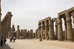 Buildings and columns of ancient Egyptian megaliths. Ancient ruins of Egyptian buildings. Royalty Free Stock Photo