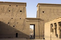 Buildings and columns of ancient Egyptian megaliths. Ancient ruins of Egyptian buildings. Giza Museum Complex, Egypt - 27 August 2017: Buildings and columns of Royalty Free Stock Photography