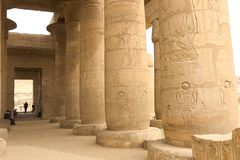 Buildings and columns of ancient Egyptian megaliths. Ancient ruins of Egyptian buildings. Royalty Free Stock Photos