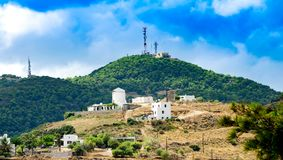 Buildings and communication antenna towers in Skyros island.Spor Royalty Free Stock Image