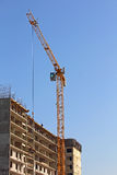 Buildings construction process with big crane. Stock Images