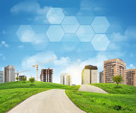 Buildings, construction site, green hills, road Royalty Free Stock Photos