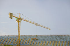 Buildings. Contractors are roofing on tall buildings Stock Images