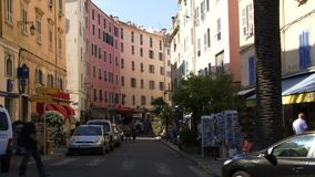 Street In Corsica. Buildings in Corsica with shops below stock footage