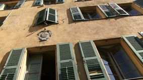 Panning shot of building in Corsica with shutters. Buildings in Corsica with shutters stock video footage