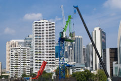 Buildings and cranes in Bangkok, Thailand Royalty Free Stock Photography