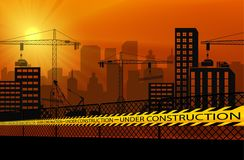 Buildings with cranes and under construction caution barrier tapes Stock Images