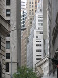 Buildings crowding the street Royalty Free Stock Images