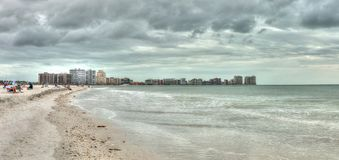 Buildings in the distance on Marco Island, Florida, beach. Under an overcast sky in winter royalty free stock images