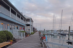 Buildings, docks and boats at sunset in Beaufort, North Carolina Stock Photography