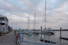 Buildings, docks and boats at sunset in Beaufort, North Carolina Royalty Free Stock Image