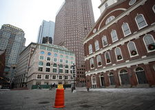 Buildings in Downtown Boston. Old, historic and modern buildings sit side-by-side in downtown Boston.  Distortion from wide angle lens. Warning sign for falling Royalty Free Stock Image