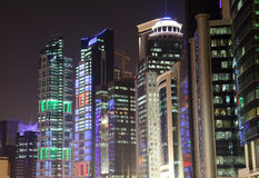 Buildings downtown in Doha at night Stock Photo