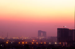 Buildings at dusk in Noida India. Buildings in Noida at dusk with the lights shining bright. The cityscape of noida is now being modernized with the addition of Stock Images