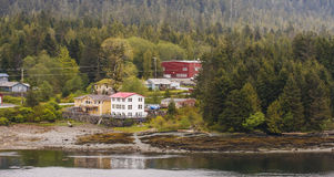 Buildings in Evergreens on Alaskan Waterway Royalty Free Stock Photography