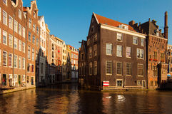 Buildings facing a canal in Amsterdam royalty free stock photos
