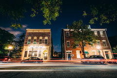 Buildings on Fairfax Street at night, in the Old Town of Alexand Stock Photos