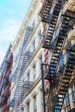 Buildings with fire escape stairs in Soho, NYC Royalty Free Stock Image