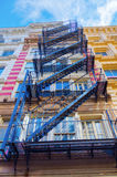 Buildings with fire escape stairs in Soho, NYC Stock Photo