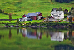 Buildings on fjord shore. In Norway Stock Photos