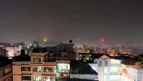 Buildings with flats at night, timelapse. Kathmandu. Nepal. Royalty Free Stock Photo