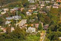 Buildings on the foot of the Monte Bre mountain in Switzerland, stock photos