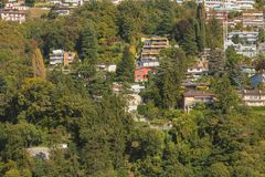 Buildings on the foot of the Monte Bre mountain in Switzerland, royalty free stock images
