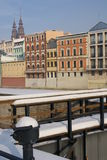 Buildings on frozen river. Landscape of buildings on river during winter Royalty Free Stock Images