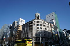 Buildings in Ginza, Tokyo, in the morning. Tokyo, Japan-February 22, 2017:Ginza is a world famous shopping district in Tokyo Stock Photography
