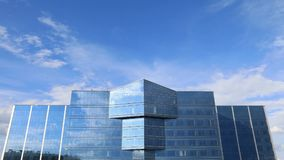 Buildings With a glass facade and time lapse clouds stock footage