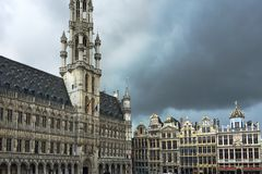 Buildings on Grand Place square, Brussels, Belgium, storm time. stock photography