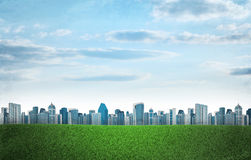 Buildings and green grass field Royalty Free Stock Photography