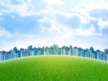 Buildings and green grass field. Architecture background Royalty Free Stock Photo