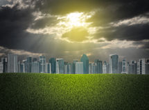 Buildings and green grass field Royalty Free Stock Photo