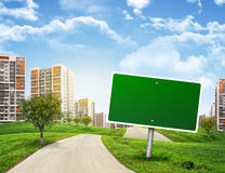 Buildings, green hills and road with empty Stock Images