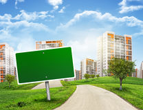 Buildings, green hills and road with empty Stock Photography