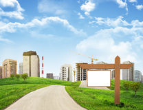 Buildings, green hills and road with wooden Royalty Free Stock Photos