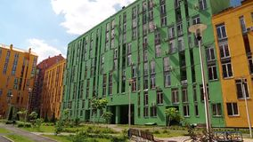 Buildings with green and yellow facades. A buildings with green and yellow facades stock footage