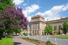City in May, Ostrava - Poruba. Buildings, greenery, flowering lilacs, road, blue sky with clouds. Ostrava-Poruba, a part of the city built in the 1950s in the stock photo