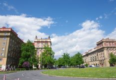 City in May, Ostrava - Poruba. Buildings, greenery, road, blue sky with clouds. Ostrava-Poruba, a part of the city built in the 1950s in the style of socialist royalty free stock photos