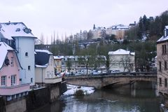 Winter in Luxemburg City. Buildings in Grund, district of Luxemburg City,  under snow. Mosel river in the center of the city Stock Photography