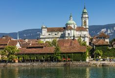 Old town of the city of Solothurn, Switzerland. Buildings of the historic part of the city of Solothurn along the Aare river, towers of the famous St. Ursus royalty free stock photography