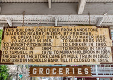 Buildings history on a sign. Sign on historic building in Northern California Royalty Free Stock Image