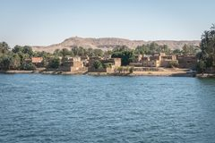 Buildings and homes on the banks of the Nile river. Egypt. Africa aswan country cityscape nilo village water architecture boat circumscription construction stock photography