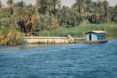 Buildings and homes on the banks of the Nile river. Egypt. Africa aswan country cityscape nilo village water architecture boat circumscription construction royalty free stock photos
